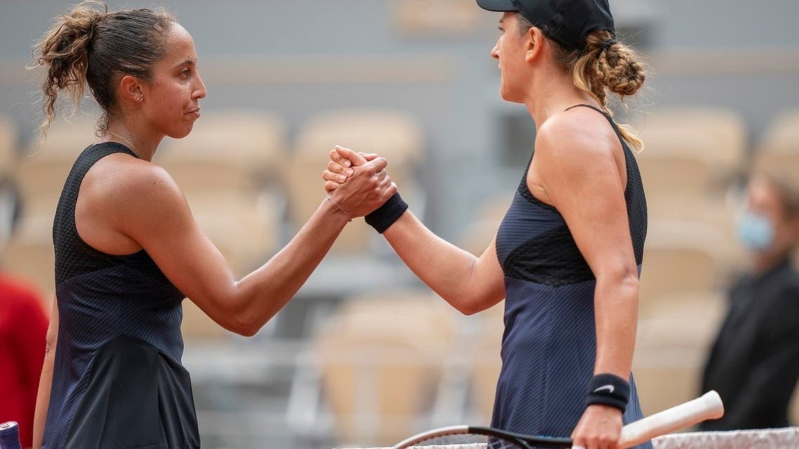 Victoria Azarenka (BLR) at the net with Madison Keys (USA) after their match on day six of the French Open at Stade Roland Garros. (Reuters)