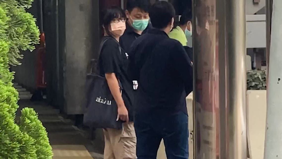 This video frame grab taken from AFPTV footage shows Chow Hang-tung (L), barrister and a leader of the Hong Kong Alliance in Support of Patriotic Democratic Movements of China, being led away by plainclothes police officers after being detained in Hong Kong on June 4, 2021, the anniversary of Beijing's deadly Tiananmen crackdown. (File photo: AFP)