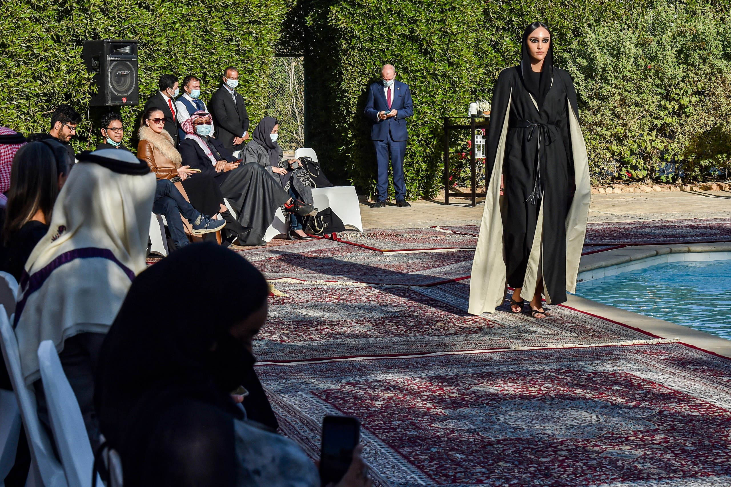 A model walks during the presentation of the Khaleeki Chic (Stay stylish) collection by Saudi and Belgian designers Safia Hussein and Christophe Beaufays, at the Belgian residence in Saudi Arabia's capital Riyadh's diplomatic quarter, on January 23, 2021. (File photo: AFP)
