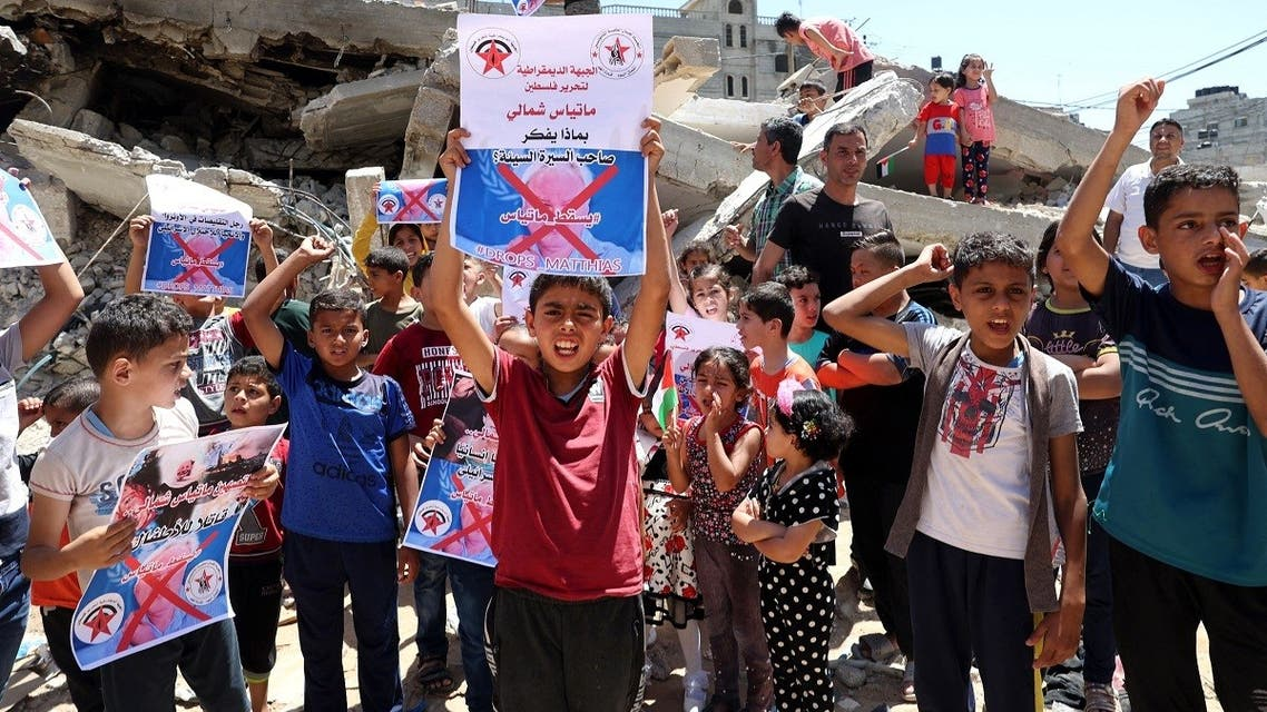 Palestinian children protest against the statements of Matthias Schmale, the director of UNRWA in the Gaza Strip, on May 27, 2021 in the Rafah refugee camp. (AFP)
