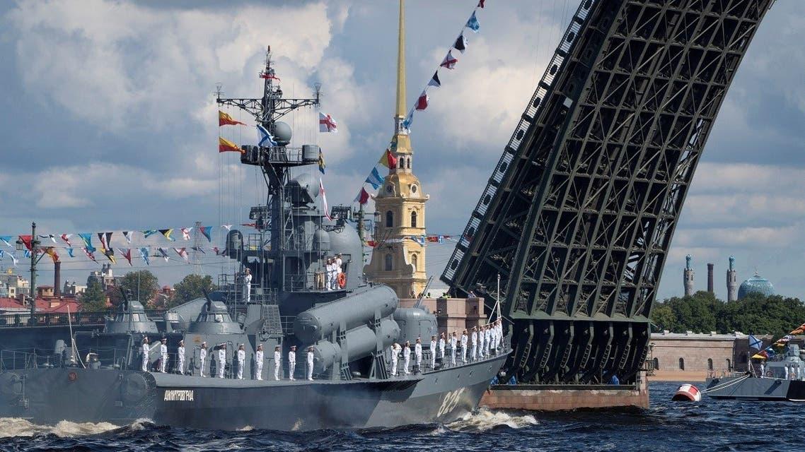 Russian Navy's missile corvette Dmitrovgrad sails past the Dvortsoviy Bridge over the Neva River in Saint Petersburg, July 26, 2020. (Reuters)