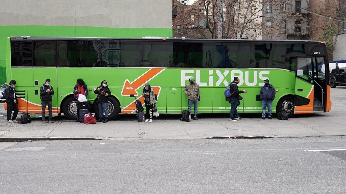 People wait for a Flixbus in the Manhattan borough of New York City, New York, U.S., November 25, 2020. (Reuters)