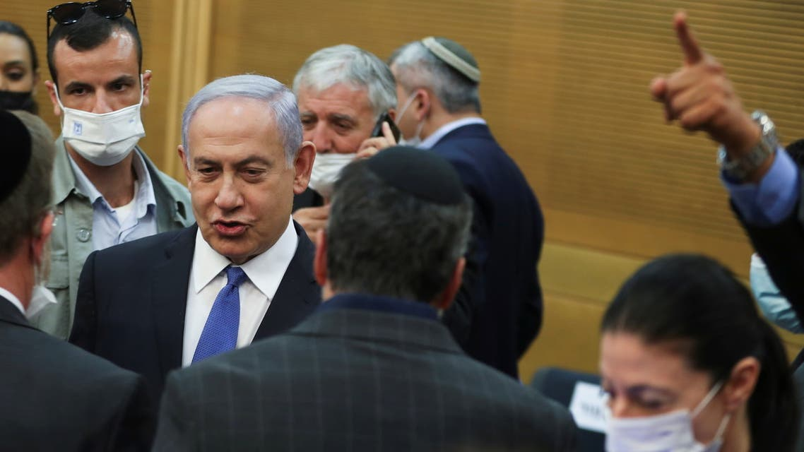 Israeli Prime Minister Benjamin Netanyahu looks on after a special session of the Knesset whereby Israeli lawmakers elected the new president, at the Knesset, Israel's parliament, in Jerusalem June 2, 2021. (Reuters)