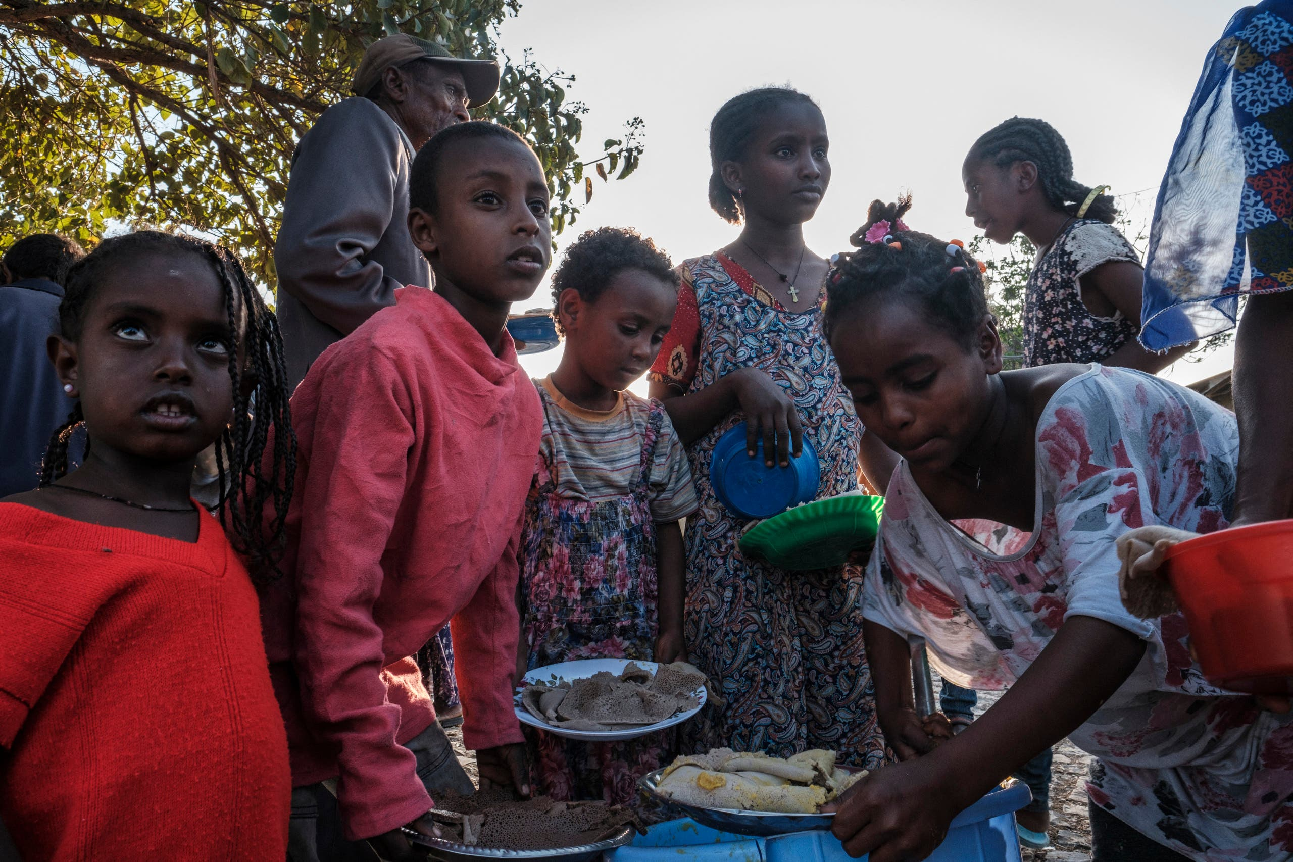 A displaced child from Western Tigray waits at meal time to receive a plate of food outside a classroom in the school where they are sheltering in Tigray's capital Mekele on February 24, 2021. (File photo: AFP)