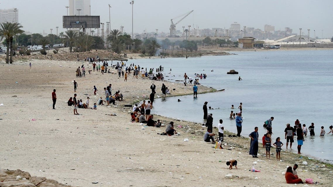 Libyans gather on a beach in the capital Tripoli on April 30, 2021. (AFP)