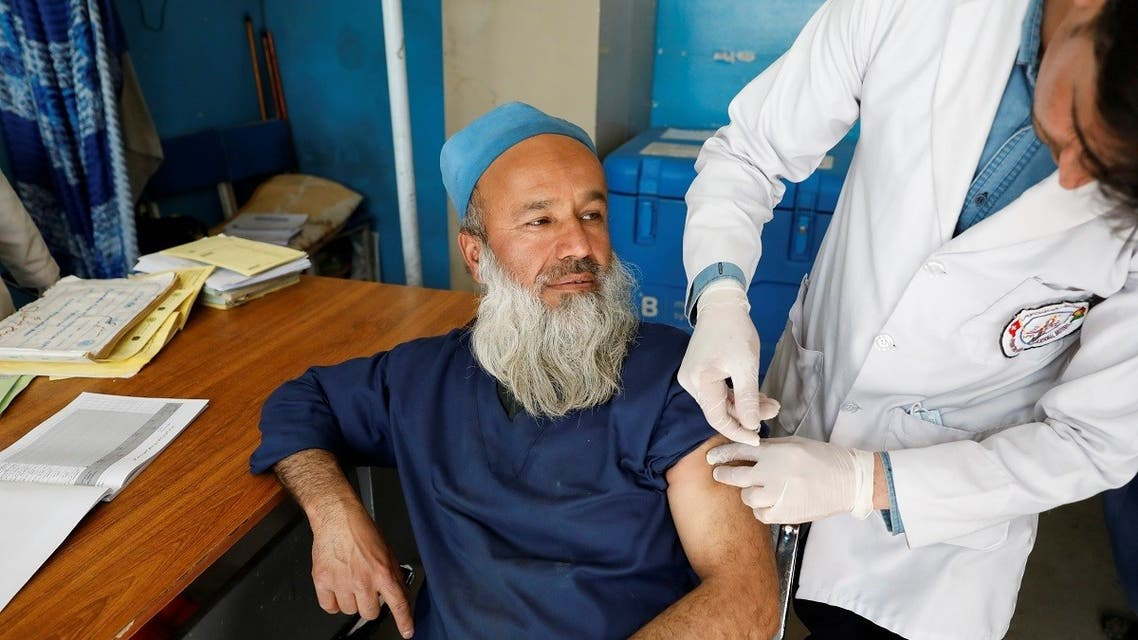 A hospital worker receives the first dose of AstraZeneca's COVID-19 vaccine at a hospital in Kabul. (Reuters)