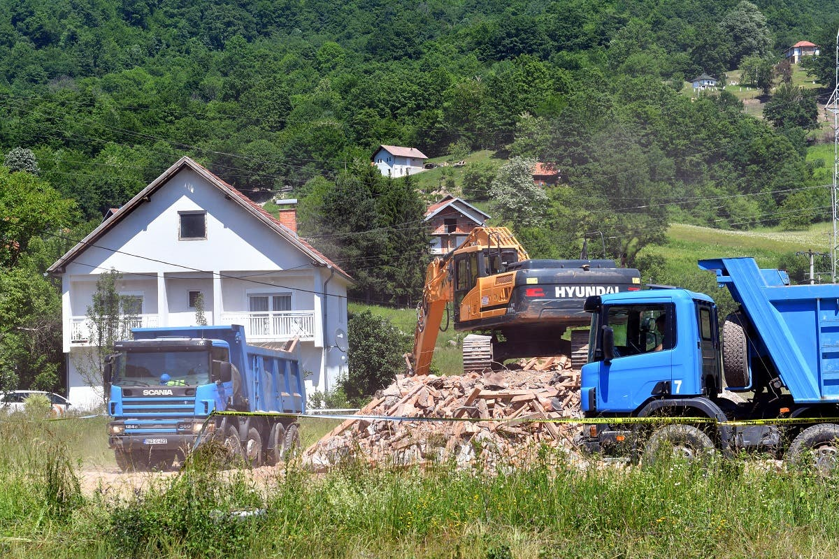 A digger is pictured next to pile of rubble coming from a demolished illegally constructed Serbian Orthodox church in Konjevic Polje, Eastern Bosnia on June 5, 2021, which was built in 1998 on land near Srebrenica, seized from Fata Orlovic, a Muslim refugee after the 1992-1995 civil war. (AFP)