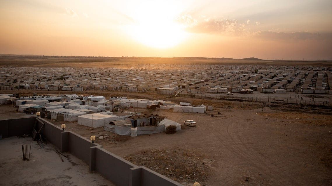 In this Aug. 24, 2019 photo, the sun sets over Sharia Camp, where Yazidis displaced by Islamic State militants are housed near Dohuk, Iraq. (AP)
