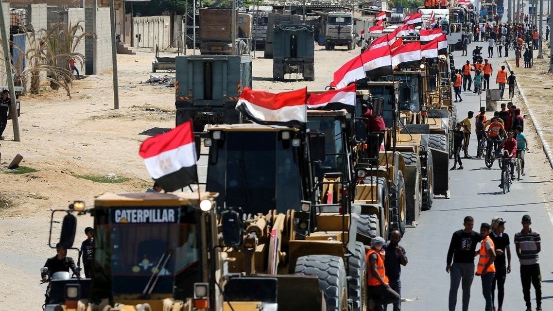Building equipment, sent by Egypt for Palestinians, arrive in the southern Gaza Strip June 4, 2021. (Reuters)