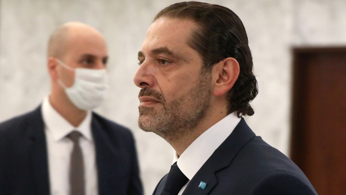 Prime Minister-designate Saad al-Hariri walks after meeting with Lebanon's President Michel Aoun at the presidential palace in Baabda, Lebanon March 22, 2021. (Reuters)