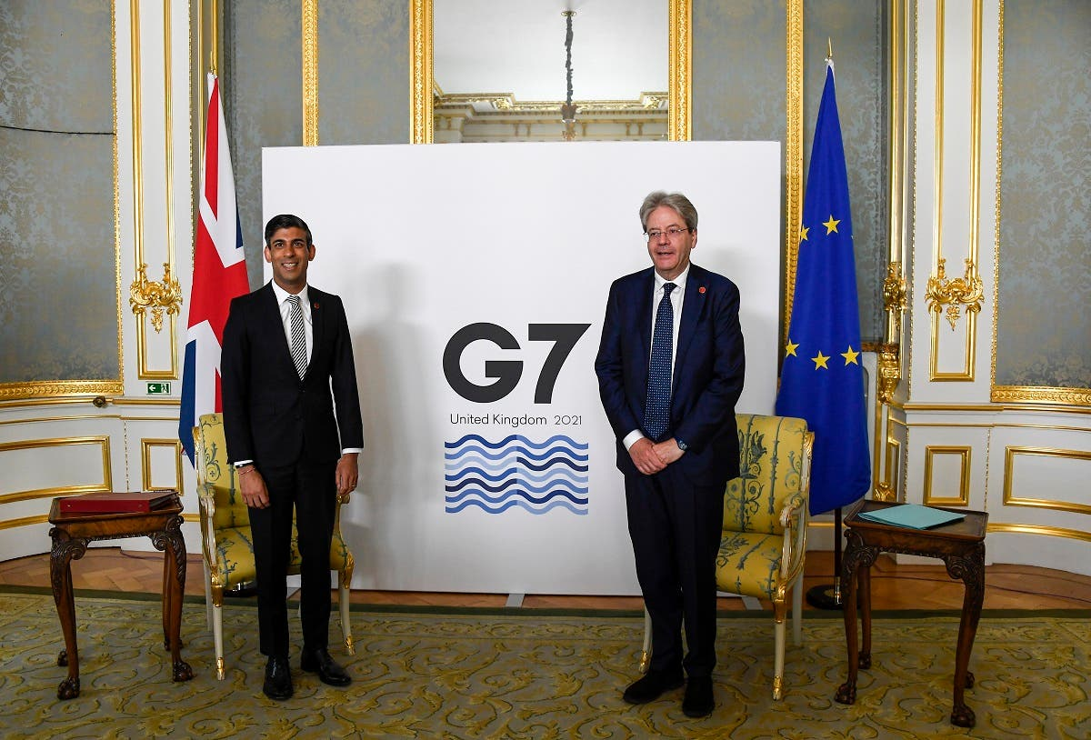 Britain's Chancellor of the Exchequer Rishi Sunak, left, and EU's Economy Commissioner Paolo Gentiloni pose for photos as finance ministers from across the G7 nations meet at Lancaster House in London, June 5, 2021, ahead of the G7 leaders' summit. (AP/Alberto Pezzali, Pool)