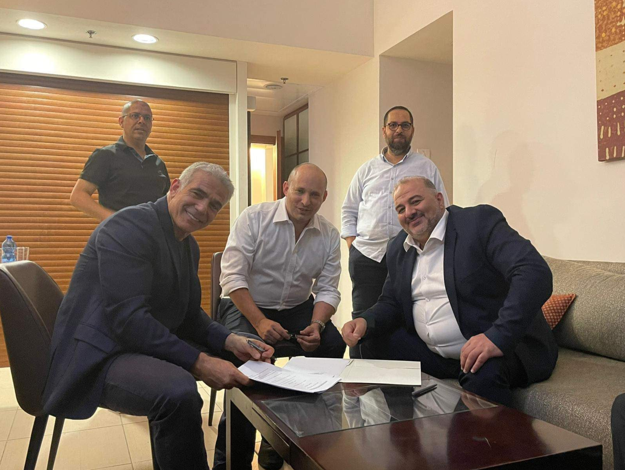 Mansour Abbas with his partners in the Israeli government