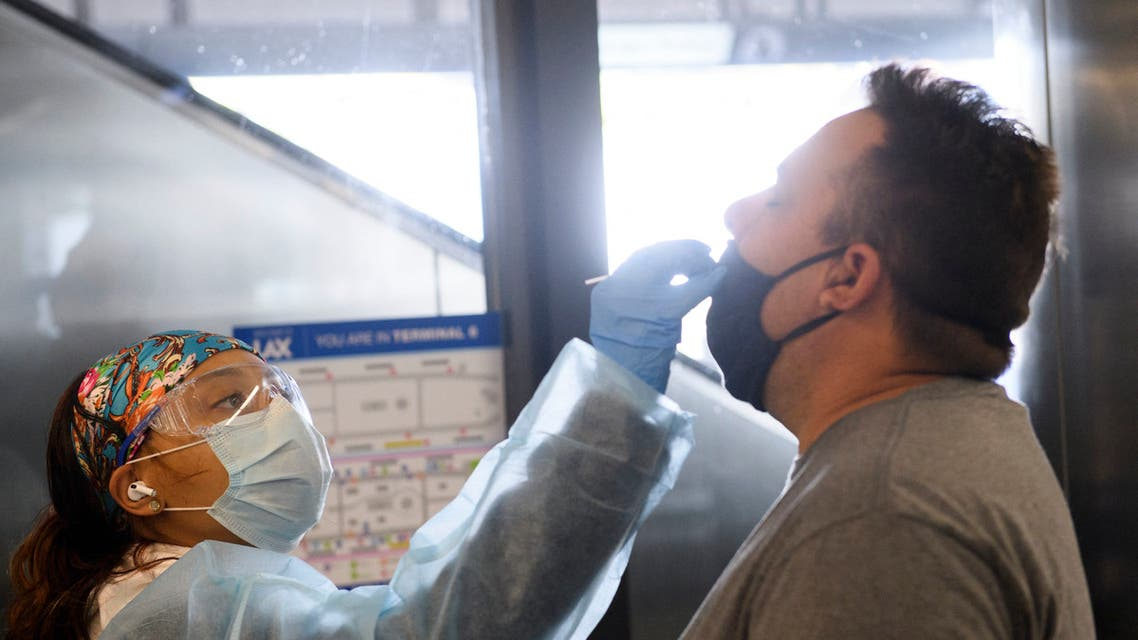 A traveler receives an in-airport Covid-19 nasal swab test a day before his flight to Hawaii during the Covid-19 pandemic at Los Angeles International Airport (LAX) in Los Angeles, California, November 18, 2020. (AFP)