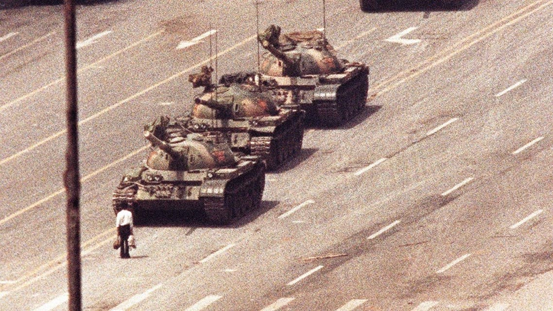 A man stands in front of a convoy of tanks in the Avenue of Eternal Peace in Tiananmen Square in Beijing in this June 5, 1989 file photo. (Reuters)