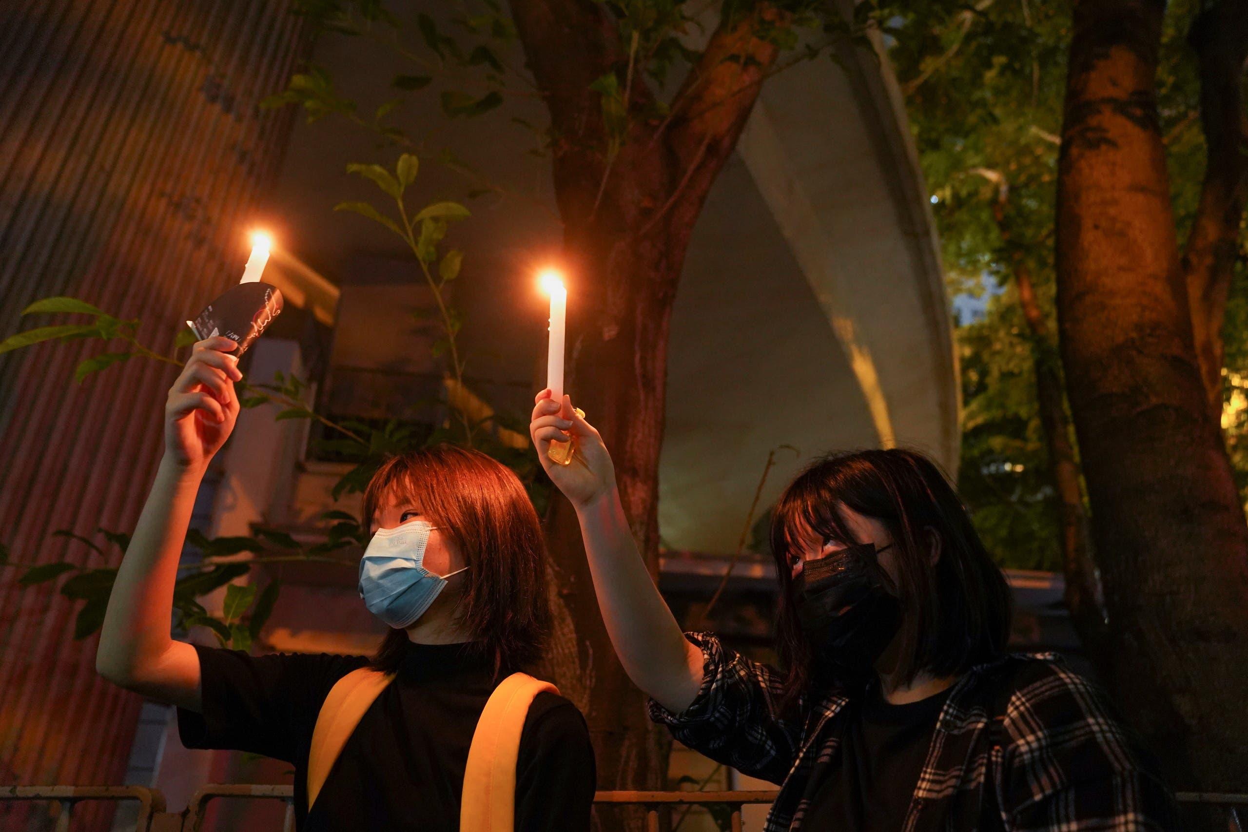 Hong Kong residents light candles on Friday night