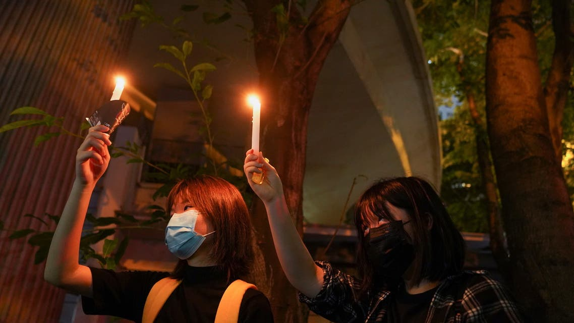 People hold candles at Victoria Park on the 32nd anniversary of the crackdown on pro-democracy demonstrators at Beijing's Tiananmen Square in 1989, in Hong Kong, China June 4, 2021. REUTERS/Lam Yik