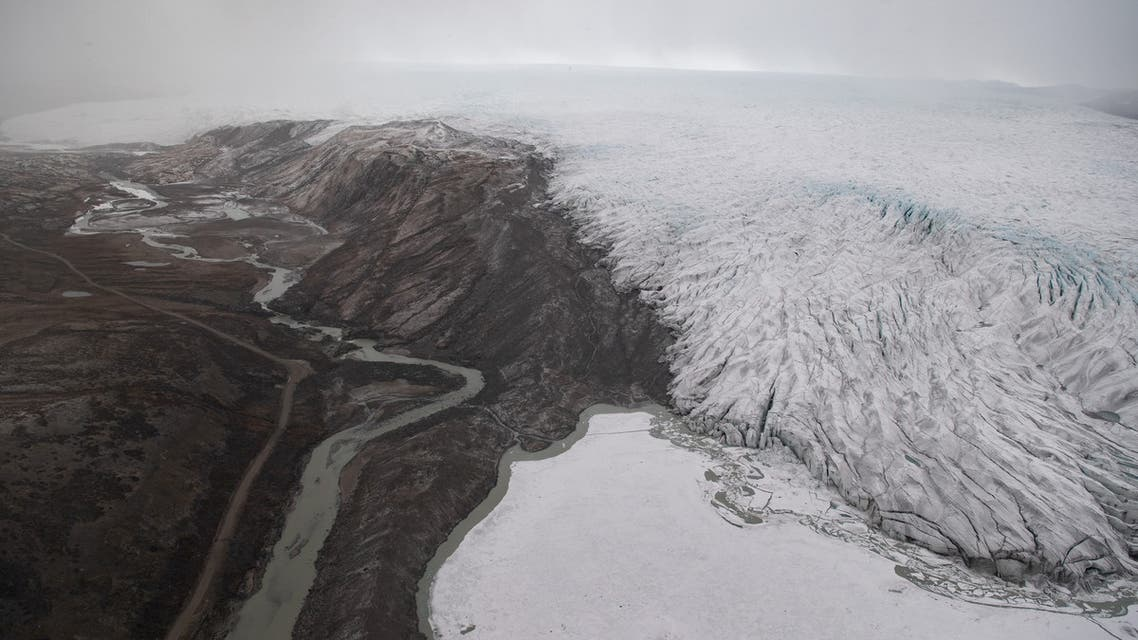 Ice receding from a glacier is seen from an aerial helicopter tour with U.S. Secretary of State Antony Blinken (not pictured) near Kangerlussuaq, Greenland, May 20, 2021. Saul Loeb/Pool via REUTERS