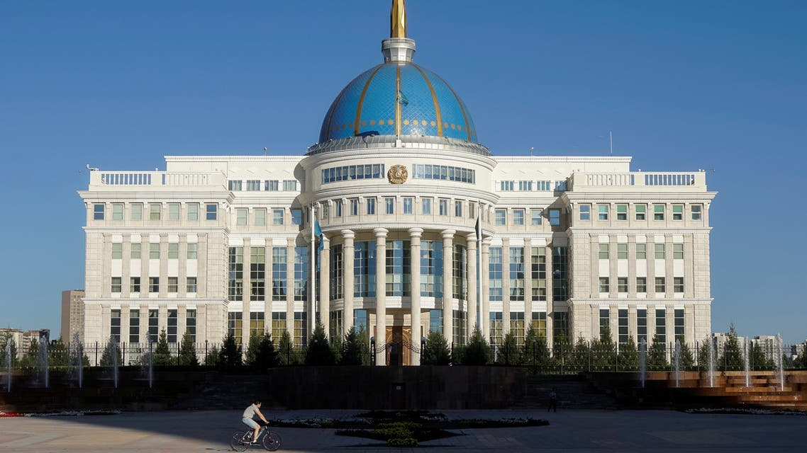 A cyclist rides in front of Akorda, the official residence of Kazakhstan's President, in Astana, Kazakhstan, September 4, 2016. (Reuters)