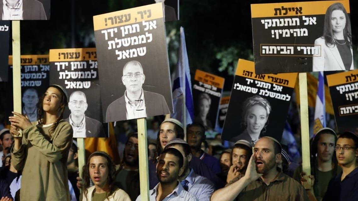 أنصار رئيس الوزراء الإسرائيلي بنيامين نتنياهو خلال مظاهرة ضد التحالف لتشكيل الحكومة - تل أبيب فرانس برس