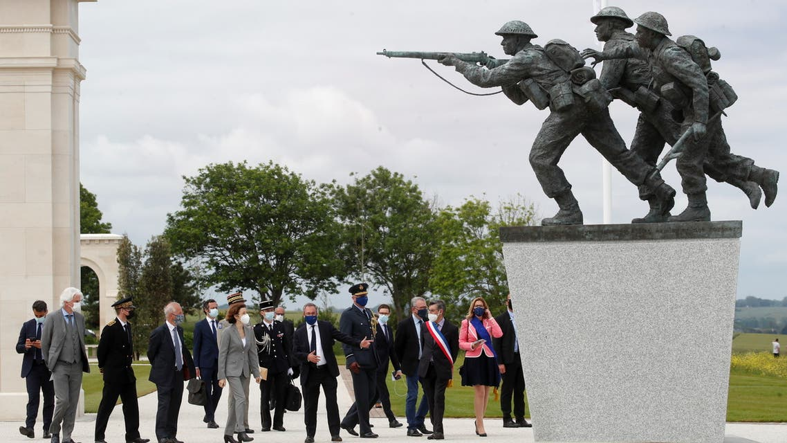 Lord Edward Llewellyn, British Ambassador to France, and France's Defence Minister Florence Parly attend the official opening ceremony of the British Normandy Memorial at Ver-sur-Mer, on the 77th anniversary of D-Day, France, June 6, 2021. REUTERS/Stephane Mahe/Pool