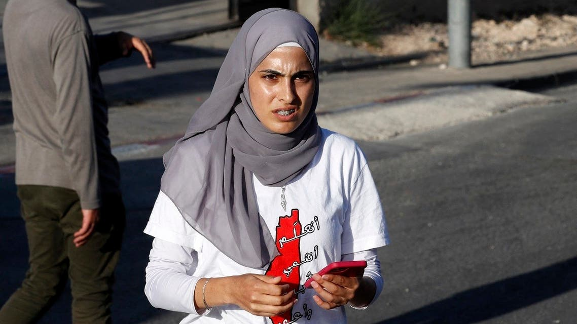 Palestinian activist Muna el-Kurd (C) takes part in a rally to demand the reopening of the Israeli Police checkpoint at the entrance of the Sheikh Jarrah neighborhood in east Jerusalem, on May 29, 2021. (Ahmad Gharabli/AFP)