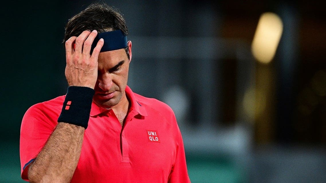 Switzerland's Roger Federer reacts as he plays against Germany's Dominik Koepfer during their men's singles third round tennis match on Day 7 of The Roland Garros 2021 French Open tennis tournament in Paris on June 5, 2021. (Martin Bureau/AFP)