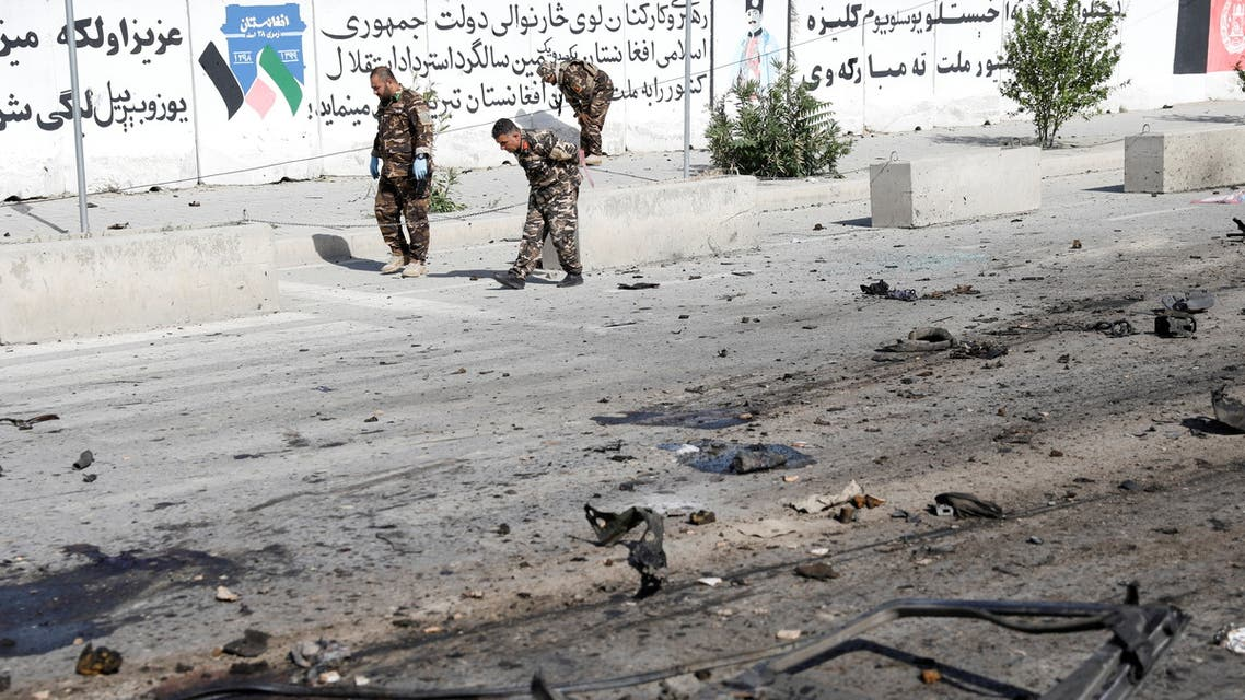 Afghan security forces inspect the site of a blast in Kabul, Afghanistan June 3, 2021. (Reuters)