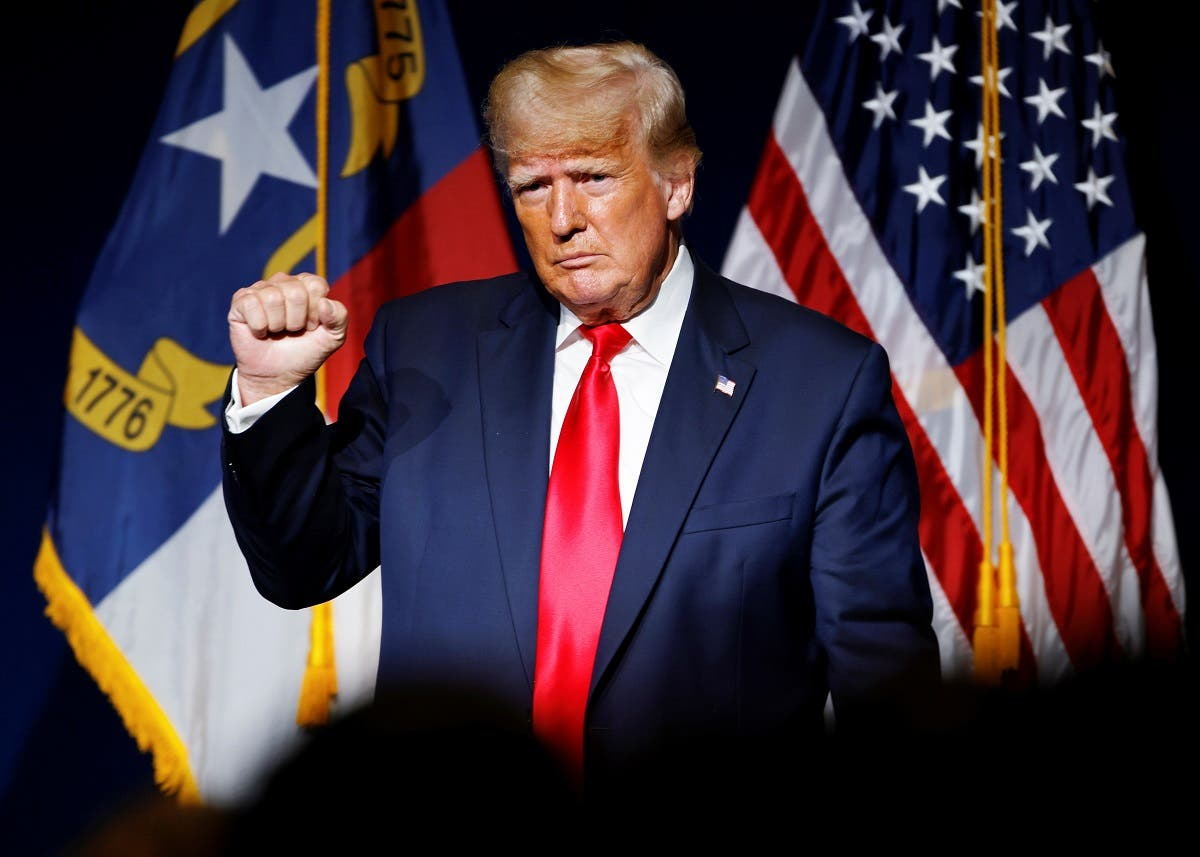 Former US President Donald Trump makes a fist while reacting to applause after speaking at the North Carolina GOP convention dinner in Greenville, North Carolina, US June 5, 2021. (Reuters)
