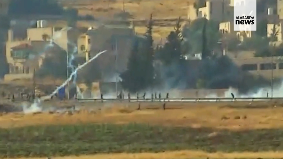 Supporters of banned lawmaker Osama al-Ajarma fired guns near the Jordanian capital Amman. (Screengrab)