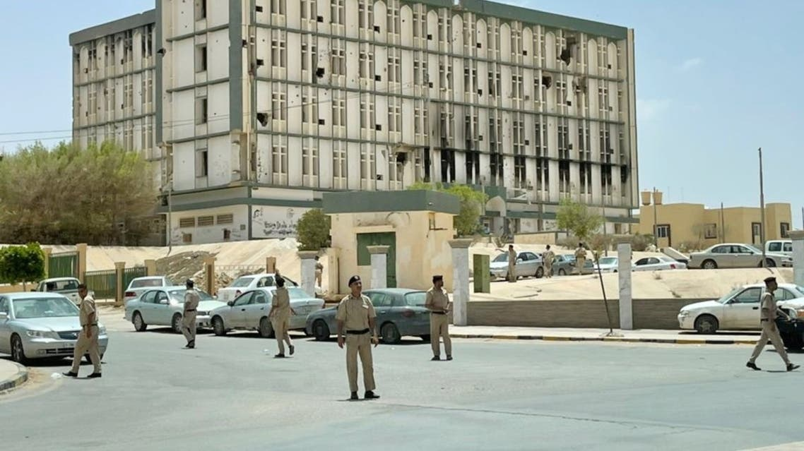 Libyan security members are seen in front of the Administrative complex in Bani Walid town, Libya, May 20, 2021. Picture taken May 20, 2021. (Reuters/Ahmed Elumami)