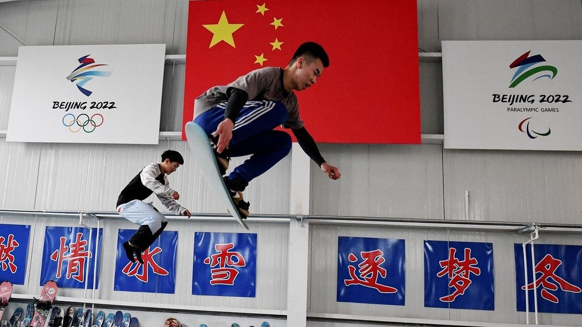Students train at a Youth Winter Olympic Sports School in Zhangjiakou, one of the venues for the 2022 Winter Olympics, on the border of Beijing in northern China's Hebei province on March 18, 2021. (STR/AFP)
