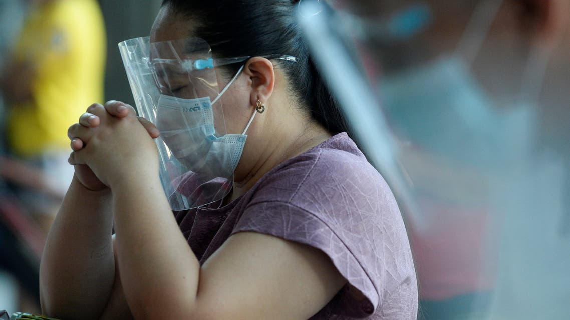 A woman wearing a face mask and a face shield as a protection against the coronavirus disease (COVID-19), prays outside the St. Peter Parish Shrine of Leaders in Quezon City, Metro Manila, Philippines, April 4, 2021. (File photo: Reuters)