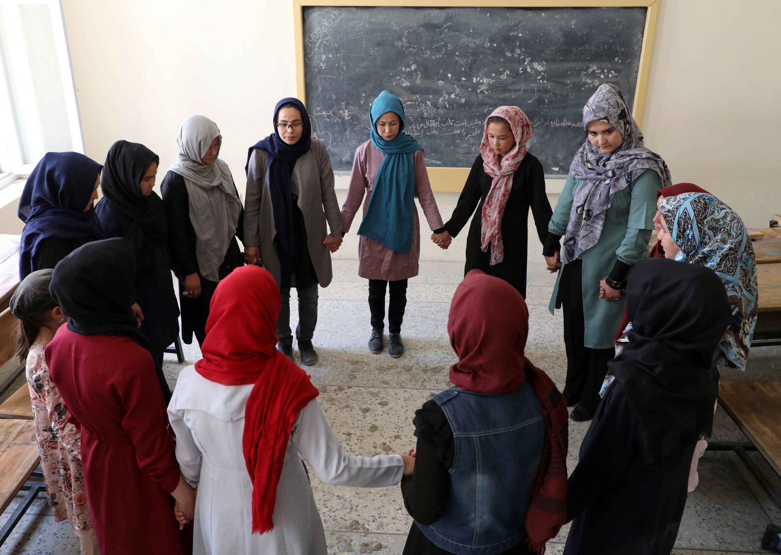 Fatima Noori, 15, (C) and other schoolgirls attend psychotherapy class after a massive bomb exploded outside their school, that killed at least 80 students in Kabul, Afghanistan May 26, 2021. (Reuters)