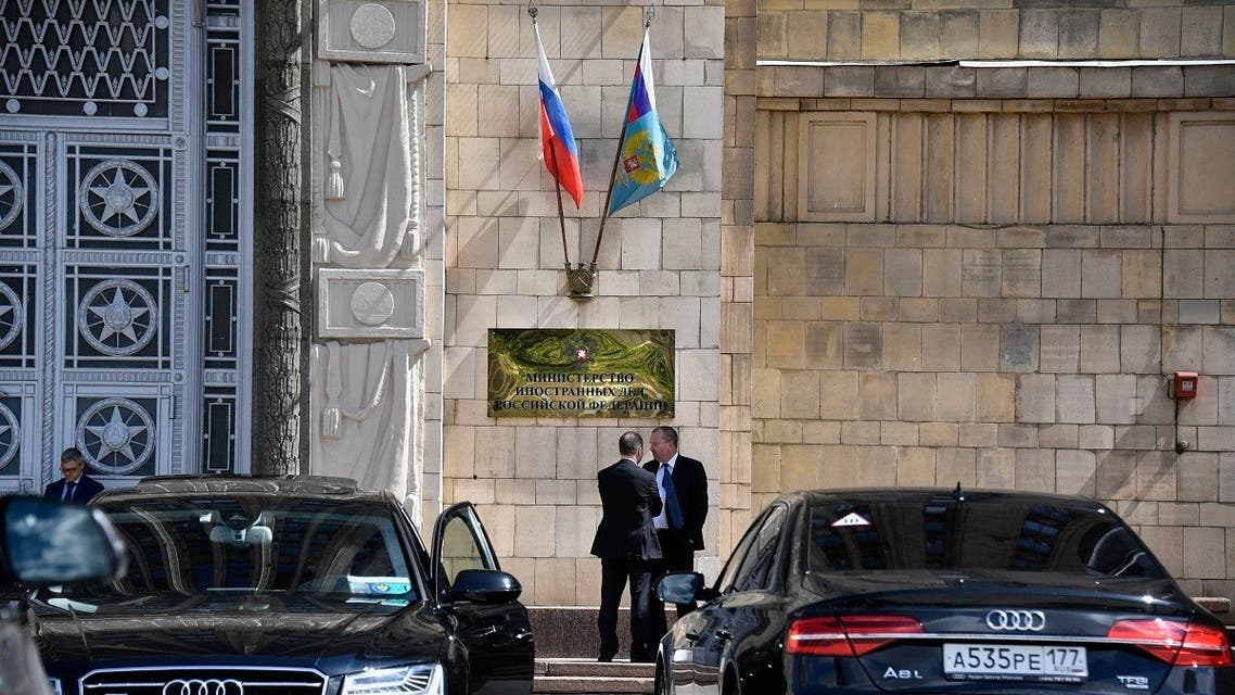 A file photo shows two men chat as they stand outside the main building of the Russian Foreign Ministry in Moscow on July 31, 2017. (Alexander Nemenov/AFP)