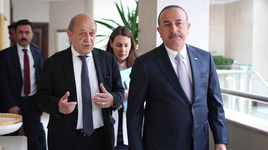 A file photo shows French FM Jean-Yves Le Drian, left, and Turkey's FM Mevlut Cavusoglu arrive for a meeting in Ankara, Turkey, Thursday, June 13, 2019. (Turkish Foreign Ministry via AP, Pool)