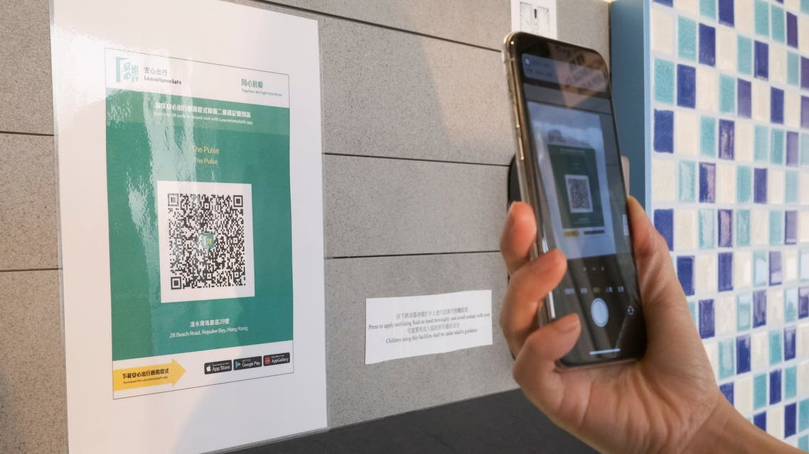 A QR code for the LeaveHomeSafe COVID-19 contact-tracing app is posted at a shopping mall, following the coronavirus disease (COVID-19) outbreak, in Hong Kong, China February 16, 2021. (Reuters)
