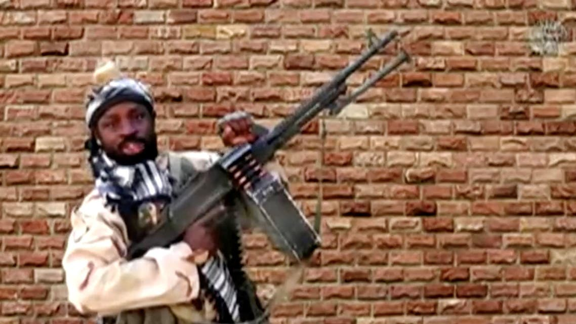 Abubakar Shekau holds a weapon in an unknown location in Nigeria in this still image taken from an undated video obtained on January 15, 2018. Boko Haram Handout/Sahara Reporters via REUTERS ATTENTION EDITORS - THIS IMAGE WAS PROVIDED BY A THIRD PARTY. MANDATORY CREDIT.