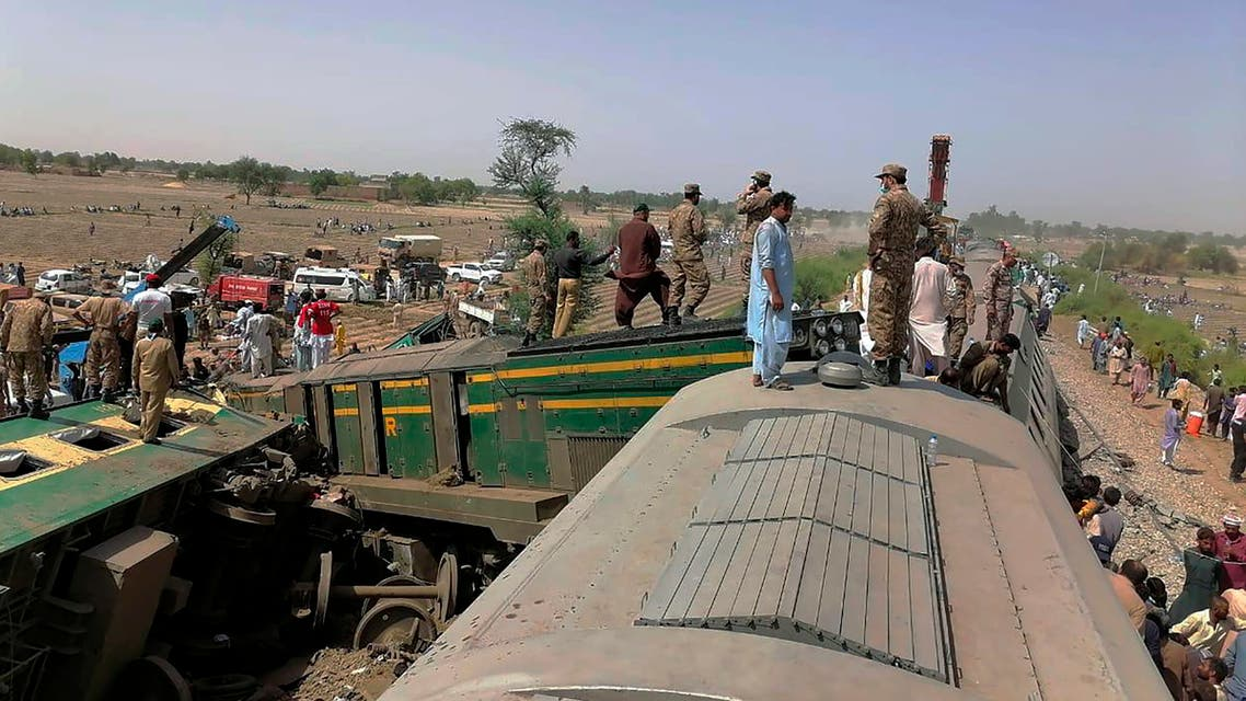 In this photo released by Pakistan's army media wing Inter Services Public Relations, troops and rescuers work at the site of a train collision in Ghotki district in the southern Pakistan, Monday, June 7, 2021. (AP)