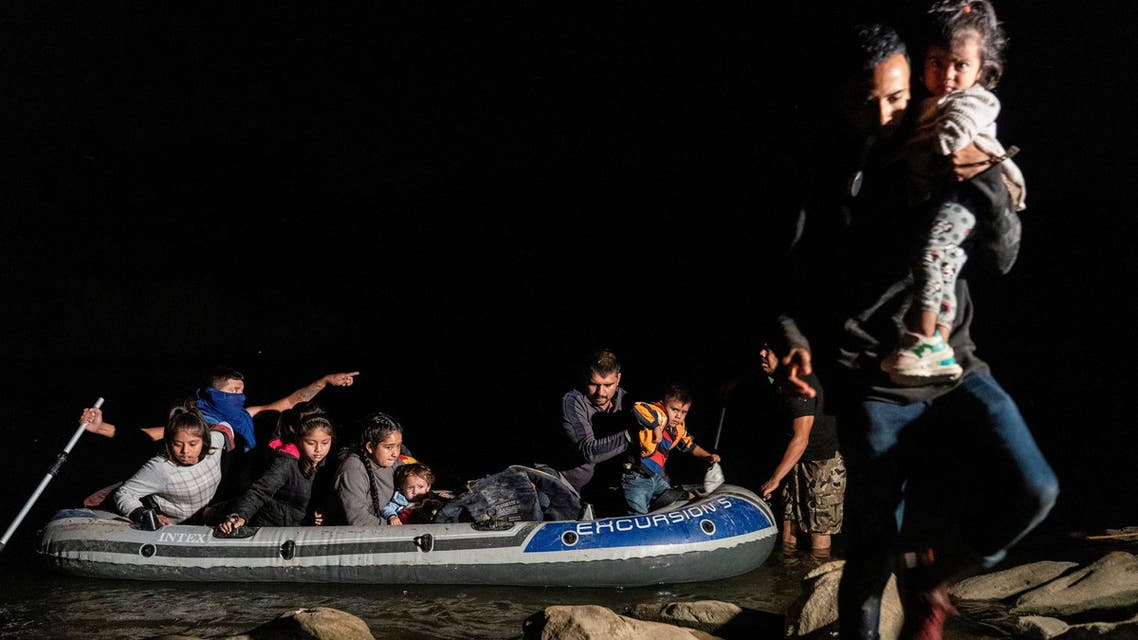 Asylum-seeking migrants' families from Guatemala disembark from an inflatable raft after crossing the Rio Grande river into the United States from Mexico in Roma, Texas, U.S., April 20, 2021. Picture taken April 20, 2021. (Reuters)