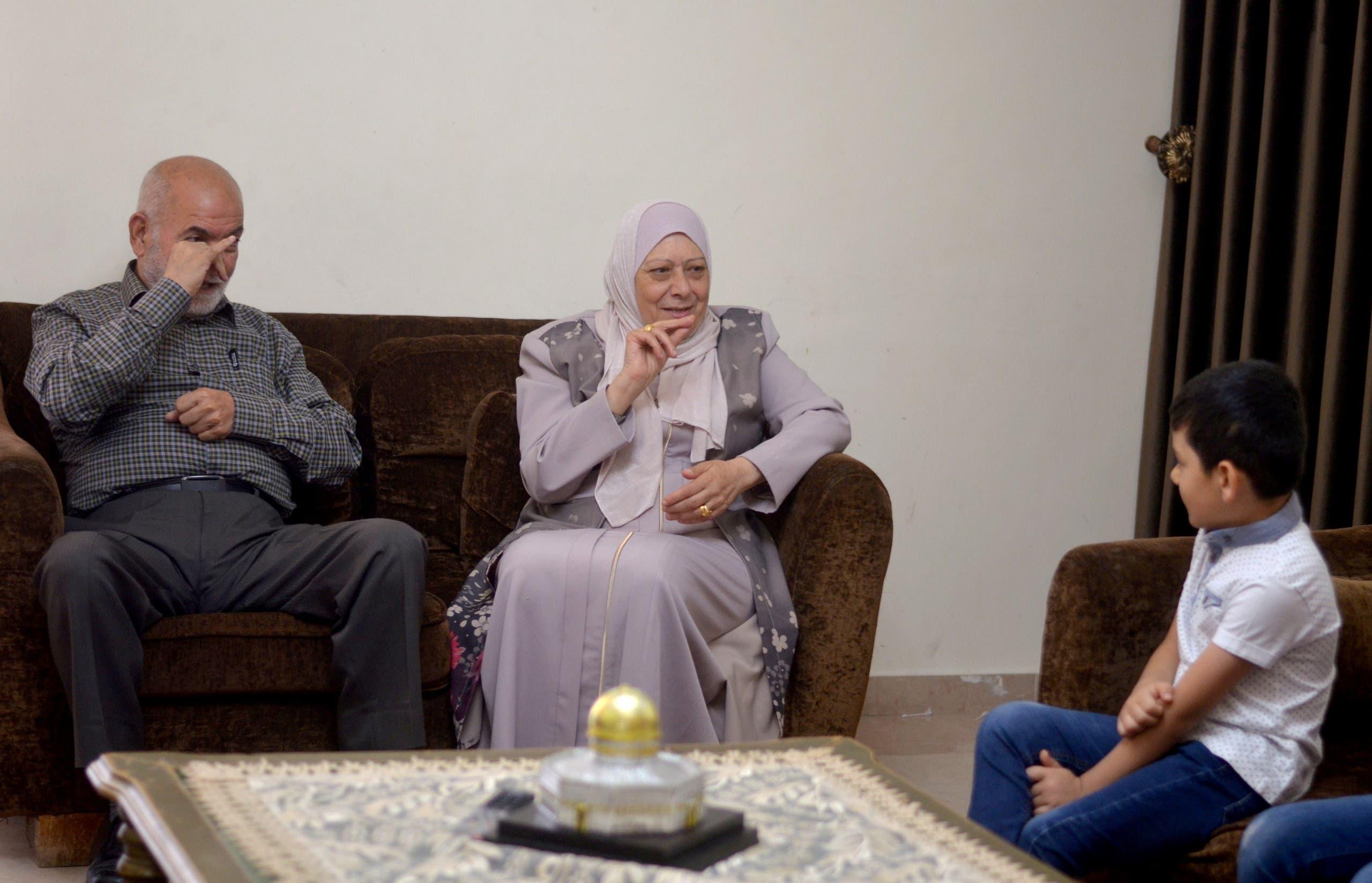 Grandparents of Aws Oudah, 5, talk to him through sign language at his home in Amman, Jordan June 2, 2021. Picture taken June 2, 2021. (Reuters)