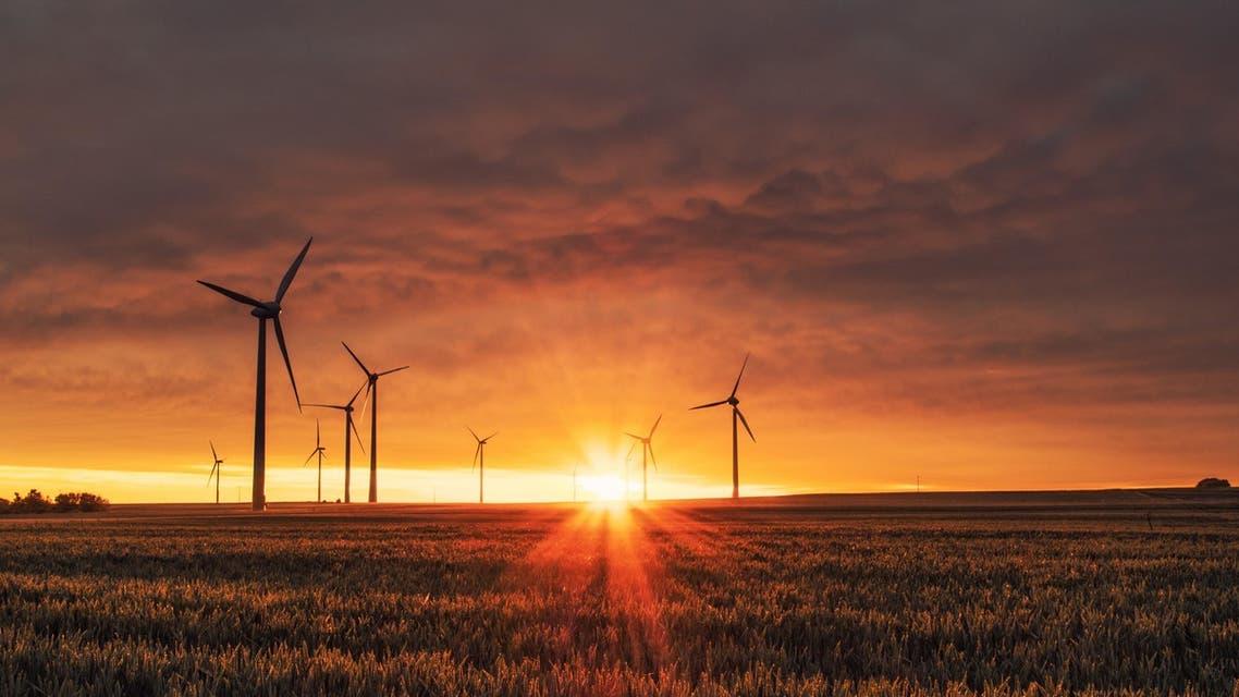 Windmills producing renewable energy in Biedesheim, Germany. (Unsplash, Karsten Wurth)