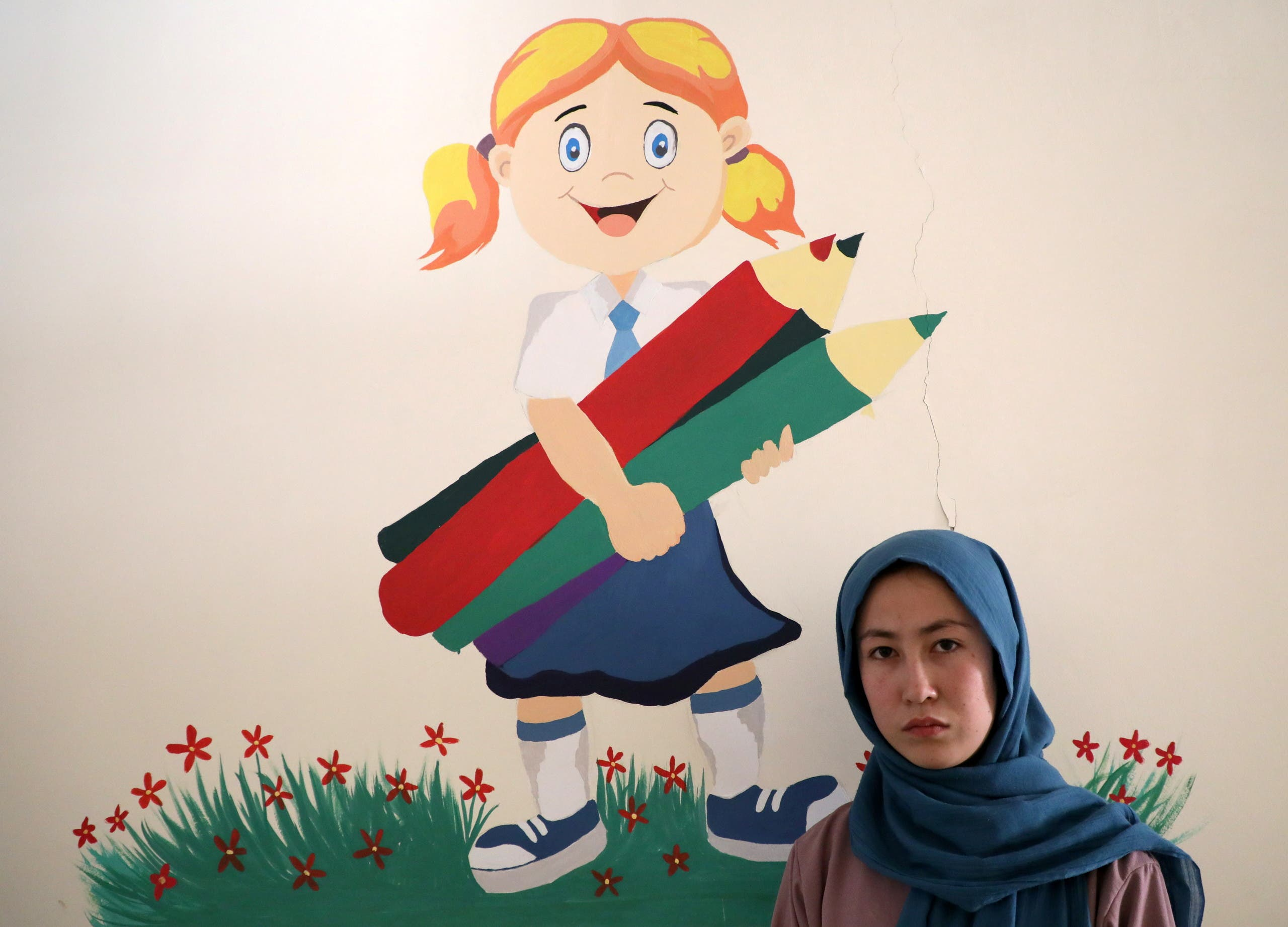 Fatima Noori, 15, poses for a photo as she arrives to attend psychotherapy class after a massive bomb exploded outside her school, that killed at least 80 students in Kabul, Afghanistan May 26, 2021. Picture taken May 26, 2021. (File photo: Reuters)