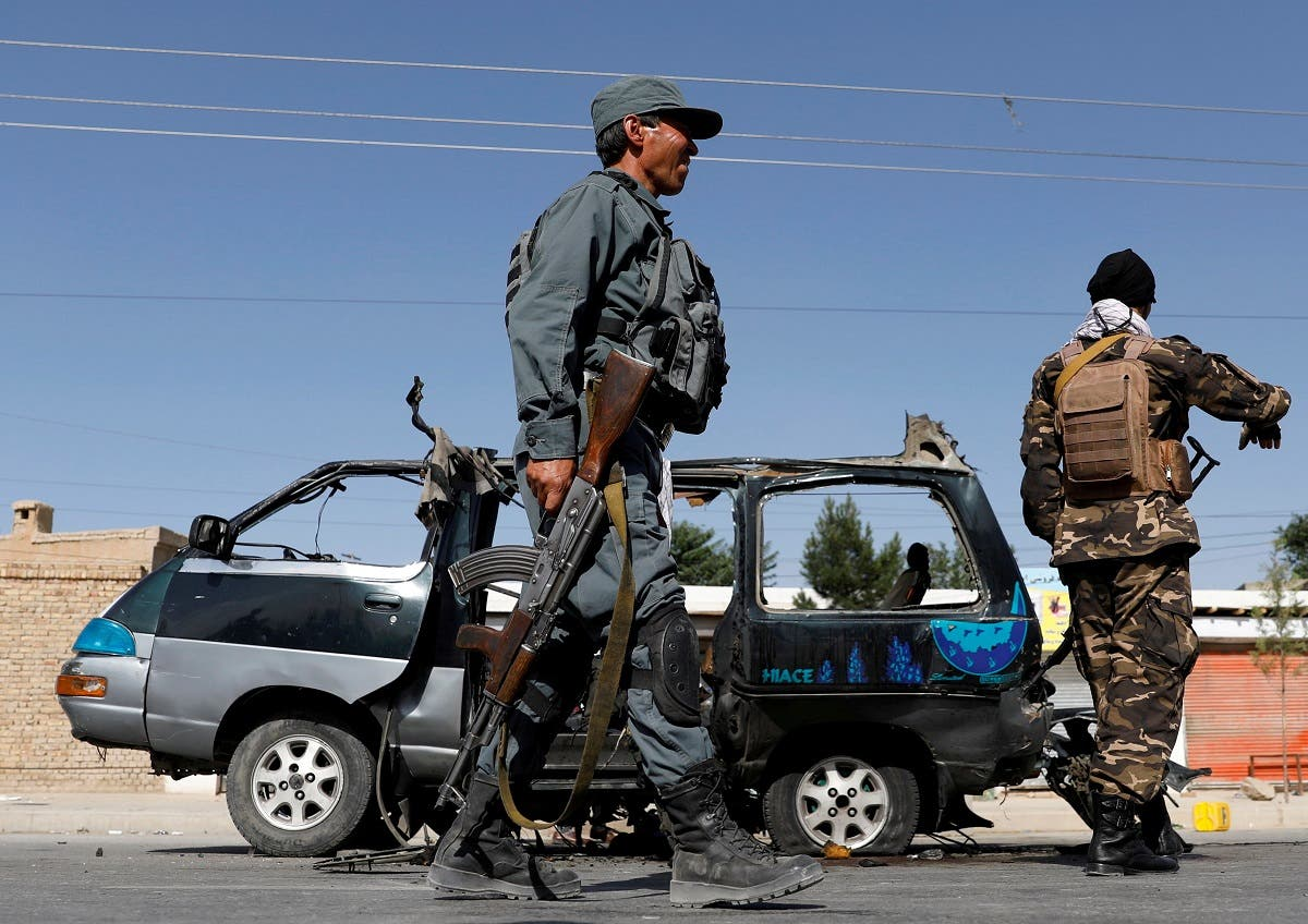 Afghan police officer inspects a damaged van after a blast in Kabul, Afghanistan, on June 3, 2021. (Reuters)