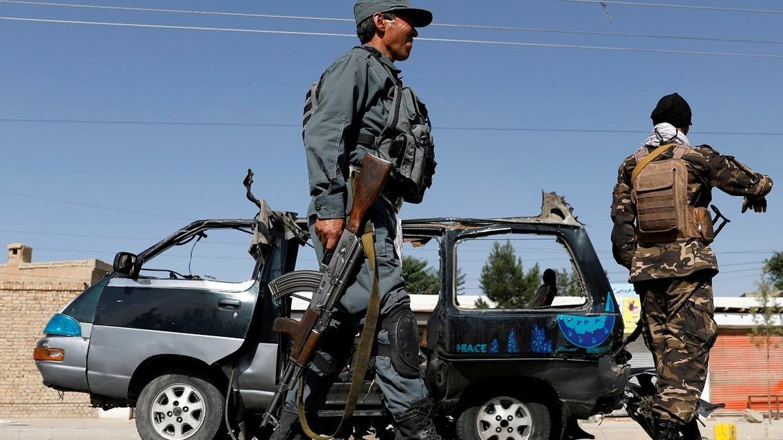 Afghan police officer inspects a damaged van after a blast in Kabul, Afghanistan June 3, 2021. (Reuters)