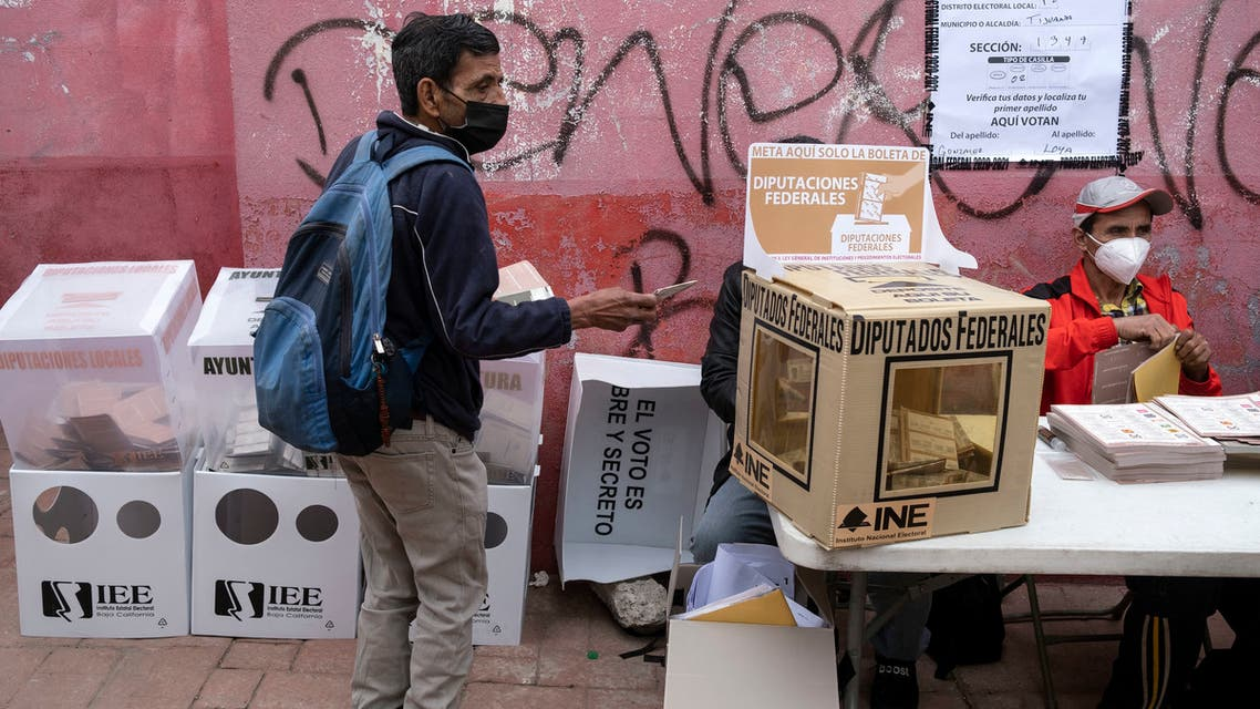 A man casts his vote at a polling station during midterm elections in Tijuana, Mexico, on June 6, 2021. (AFP)