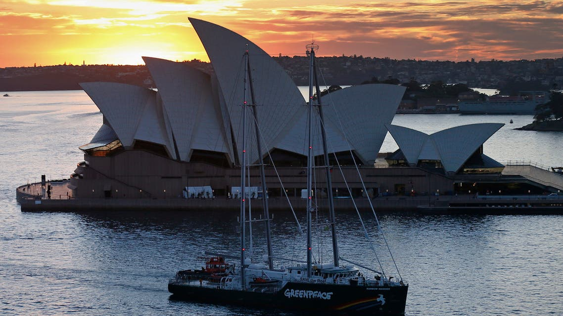The new Greenpeace Rainbow Warrior ship navigates past the Sydney Opera House March 22, 2013. The ship is on its first visit to Sydney as part of the Save the Reef Australia Tour. (Reuters)