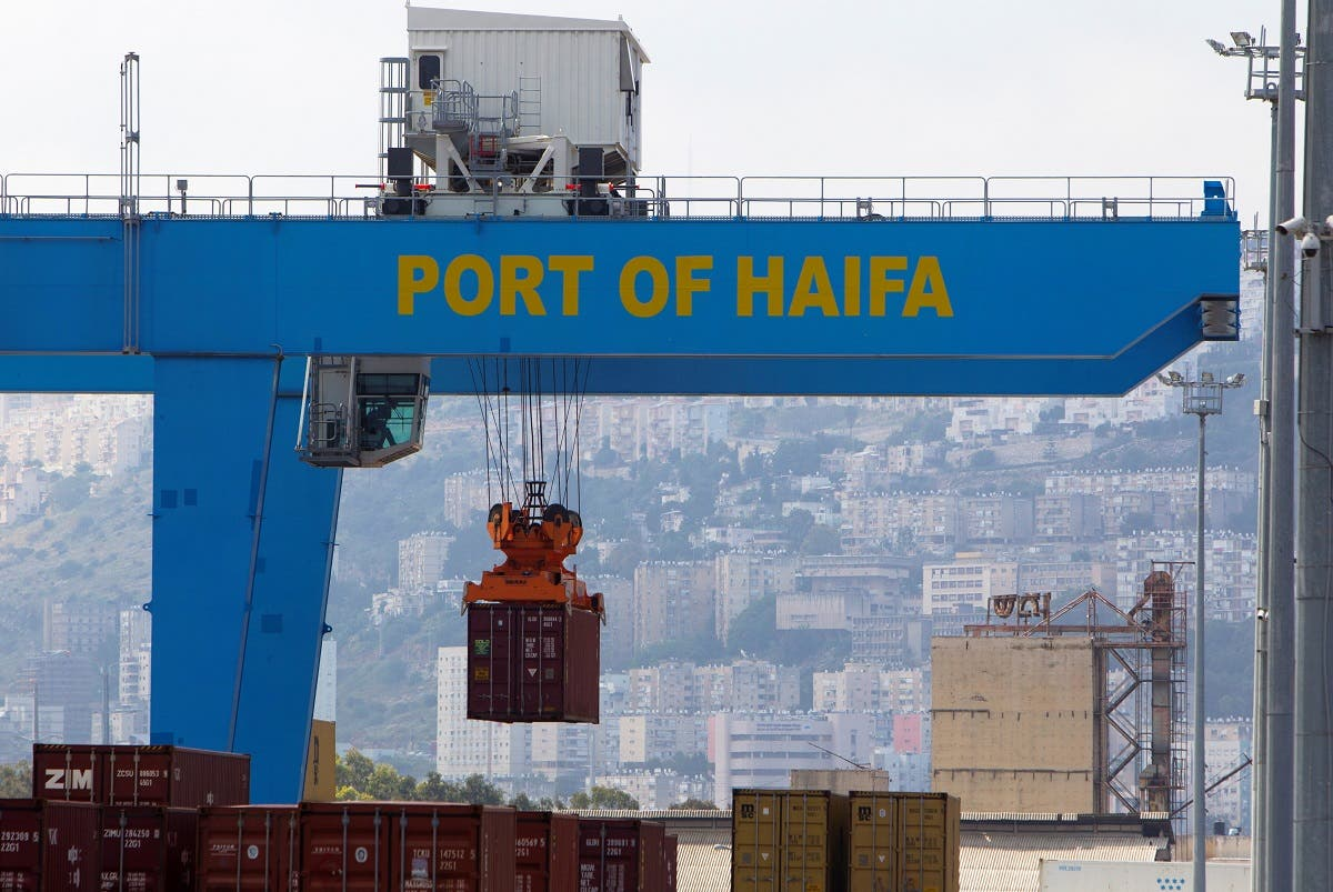 A crane unloads a container at the port of the northern city of Haifa, Israel. (Reuters)