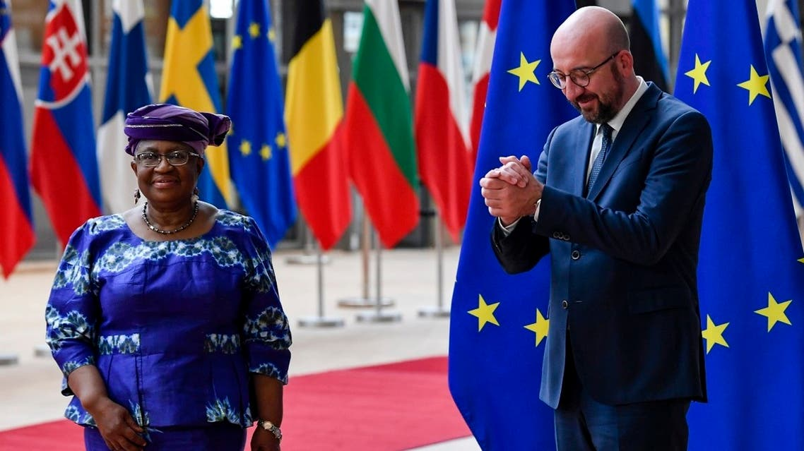 European Council President Charles Michel, right, welcomes Director-General of the World Trade Organization Ngozi Okonjo-Iweala prior to a meeting at the European Council building in Brussels, on May 19, 2021. (AP)