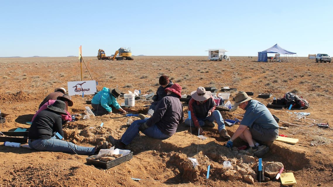 This handout picture taken by Rochelle Lawrence on May 23, 2015 and released by The Eromanga Natural History Museum shows researchers digging for dinosaur fossils in Cooper Creek, the area near the town of Eromanga, in western Queensland where the fossils were discovered in 2007. A gigantic dinosaur discovered in Australia's outback has been identified as a new species and recognised as one of the largest to ever roam the Earth, according to palaeontologists on June 7, 2021. (File photo: AFP)