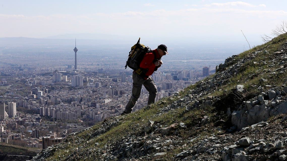 A hiker ascend a foothill of the Alborz mountain range, overlooking the capital Tehran. (File photo: AP)